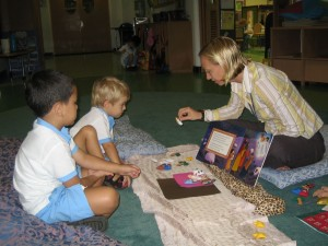 Teacher from British International School in Phuket, Thailand telling a story can story along with a book the day after the workshop.